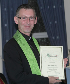 Reverend Colin Fry proudly displays his United Spiritualists ordination certificate.