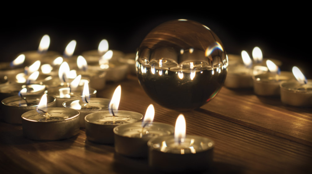 Crystal ball and candles